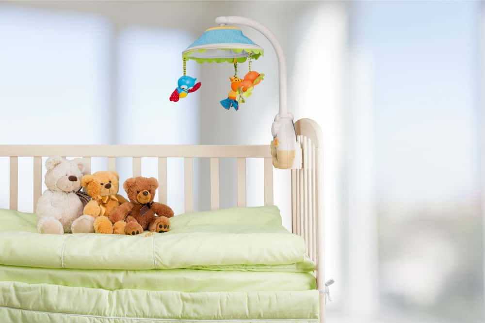 How to assemble a drop side baby crib